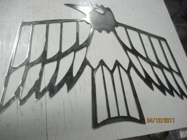 On arrival, a bare CNC cut Pontiac Firebird emblem ...