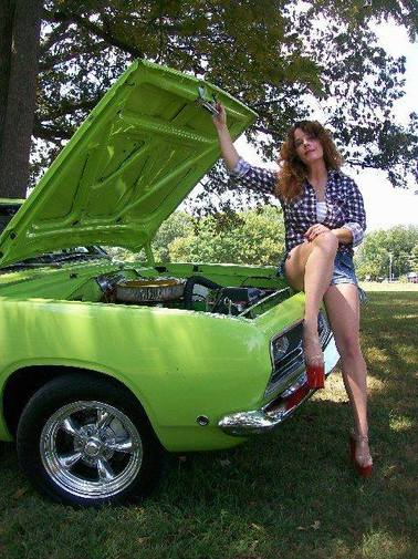 PSC's Owner/Operator, Leanna Johnson, and her 1968 Plymouth Barracuda Fastback
